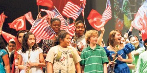 At a Gulen charter school, American students hold Turkish and American flags